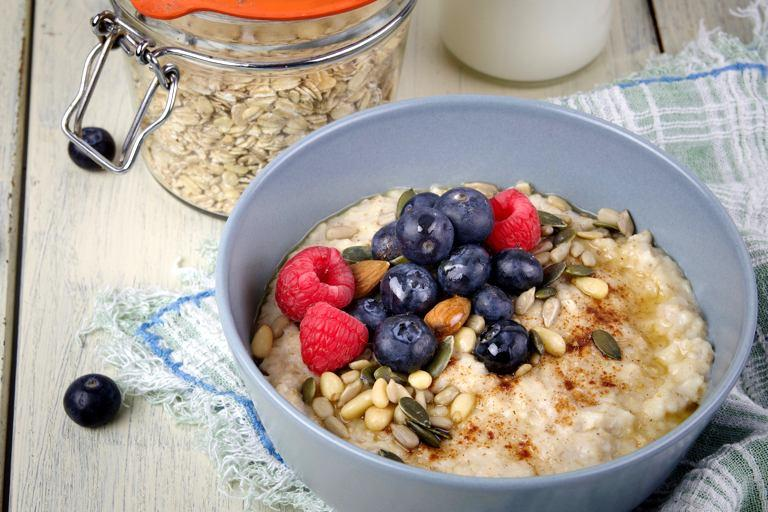 Oatmeal topped with a vibrant mix of berries, nuts, and seeds